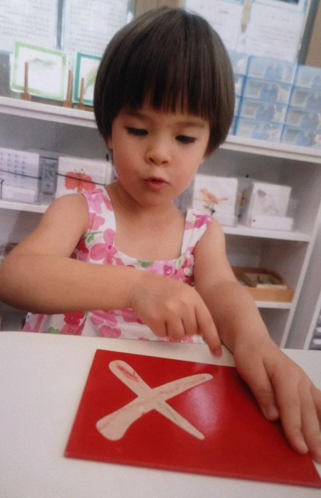 Mackenzie learning the Chinese Alphabet
